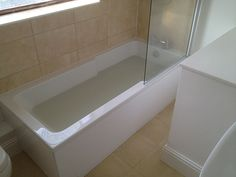 Shower Bath w/ Solid Panels in a Bathroom Installation Project by UK Bathroom Guru