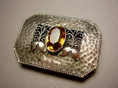 Hermann Haussler (attrib.) for Theodor Fahrner. 935 silver and citrine brooch. TF monogram trademark, 935 for a higher silver content than sterling and the word Depose. View 3.