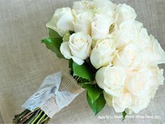 Simple and elegant wedding bouquet - Ivory roses.  Burlap and lace stem wrap