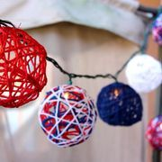 Light Up the Fourth of July with Patriotic Red, White and Blue Yarn String Lights | eHow