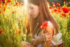 #brunette on a #poppy #field with #backlight