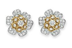A PAIR OF DIAMOND AND GOLD EAR CLIPS, BY JEAN SCHLUMBERGER, TIFFANY & CO.  Each designed as a circular-cut diamond flower blossom with sculpted 18k gold detail, mounted in 18k gold and platinum  Signed Schlumberger Studios for Jean Schlumberger, Tiffany & Co., no. 19113906