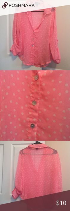 A coral/hot pink polka dot blouse This is a fun coral/hot pink loose blouse from Kohls! The hem at the bottom is a little bit longer in the middle and curves up a slightly to the sides. I wore it a few times by wearing a cami and tying up the front shirttail! Worn less than 5 times, no flaws! Kohls Tops Button Down Shirts