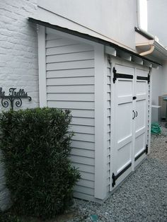 A small but attractive shed set along the side of a house. With some shelves, it can store quite a bit, all with easy access. Can also be placed next to a fence.