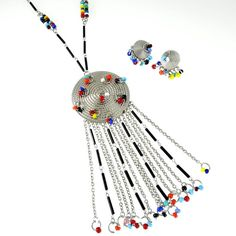 Vintage Southwest Native American Style Silver Tone Bright Glass Bead Fringe Medallion Necklace and Earring Set    https://www.etsy.com/listing/158368149/vintage-native-american-necklace-and?ref=shop_home_active_17