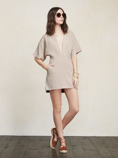 Just a really chic dress that's also breathing-friendly. The Azura Dress lets you feel comfortable while also highlighting some of those special parts. This is a loose-fitting mini dress with a deep V neckline, kimono sleeves and side pockets. The fabric is a textured woven, like linen. Made from surplus linen blend.