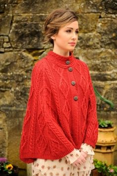 The Ladies Merino Wool Buttoned Cape, knit in a tantalizing array of Aran stitches is a chic Irish wrap that has an easy and comfortable fit. Made in Ireland by Carraig Donn in 100% merino wool. One size fits most.