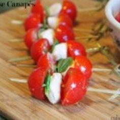 1 pint cherry tomatoes, halved width wise 1 c mini mozzarella pearls 1 t kosher salt 4 T white balsamic vinaigrette 2 T light high-quality olive oil 30 small basil leaves toothpicks