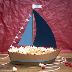 Need a nautical centerpiece for your kid's party? We've come up with an amazing, easy-breezy paper sailboat snack holder project. Kids Party Centerpieces, Kids Party Tables, Nautical Centerpiece, Diy Party Decorations, Quince Decorations, Quinceanera Centerpieces, Wedding Centerpieces, Halloween Decorations, Cruise Theme Parties