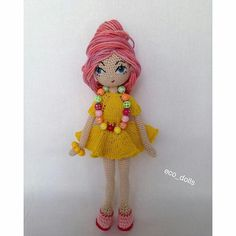 Amigurumi doll with amazing pink hair do. (Inspiration).