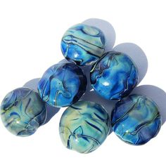 Free US Shipping for items with combined total of $50 or more! Just use coupon code FREESHIP50 on check out.    This is a set of 6 lampwork