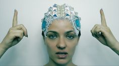 A musical headpiece that the wearer manipulates through touch to effect musical patterns in real time. The elegance of the debut offering gives way to an altogether more science fiction enthused look...