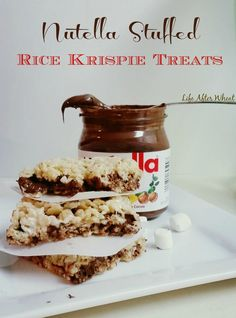 These gluten free Rice Krispie Treats are stuffed with a gooey chocolate hazelnut filling that will have everyone coming back for seconds!