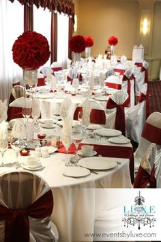 Red and white wedding reception centerpieces. Throw in some black and silver accents and its perfect!
