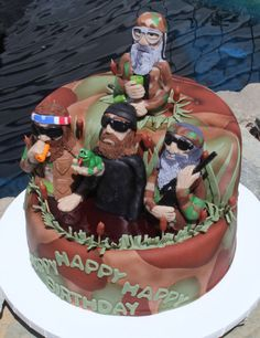 What a challenge this cake was! Besides I knew absolutely nothing about Duck Dynasty, they asked for the 4 main characters on the cake! I dont know about anyone else, but my people sculpting skills are not my favorite. Practice, practice I guess :) So here is the cake with all 4 guys.