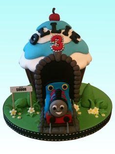 Children's Birthday Cakes - Thomas the Tank Engine giant cupcake Giant Cupcake Mould, Big Cupcake, Giant Cupcake Cakes, Wilton Cupcakes, Thomas Tank Engine Cake, Thomas Engine, Cupcake Gigant, Thomas Birthday Parties, 3rd Birthday