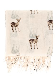 This Deer Print Scarf is constructed in a lightweight gauzy fabric and features an all over deer print with fine tassels, making this the perfect layering piece for the changing seasons. From Warehouse.