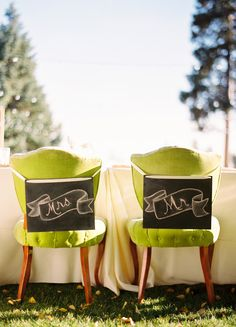 the only thing better than those Mr. and Mrs. signs are the fabulous green chairs that they're hanging from  Photography By / ryanrayphoto.com