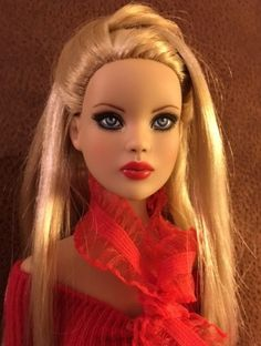About Pretty in Red: Brooke is a Cami repaint by Dawn Aldous Originals. She wears a sweater by Hazel Street Dezigns.