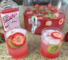 Sweet Revenge Strawberry Jungle Juice! Strawberry slices, kiwi slices, 2 bottles of Sweet Revenge, 3 bottles of lemonade, 1/2 bottle white rum, few splashes of grenadine. Enjoy! Perfect for BBQ's and summertime!