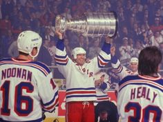 Mark Messier celebrates with his 1994 New York Rangers teammates, including Brian Noonan and Glenn Healy after winning the Stanley Cup
