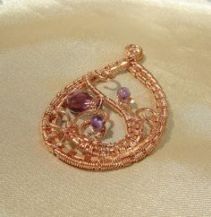 wire wrapped copper pendant with purple color faceted czech briolette and tiny amethyst stones Amethyst Stone, Wire Work, Wire Wrapped Jewelry, Wire Wrapping, Wraps, Stones, Copper, Brooch, Pendant