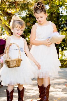 flower girls in cowboy boots with color of bridesmaid dresses around in a little flower. Too sweet. This one is for my aunt who hates boots with dresses. Lol