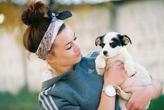 a small puppy is the cutest fashion accessory