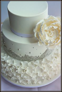 Petals and silver  White and silver wedding cake  www.facebook.com/toocutetocut