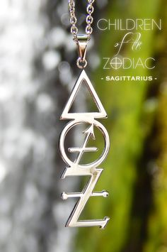 """Harness the power of the stars with this Sagittarius Zodiac Necklace. A subtle reminder of that which you are destined for.  ★ The Vertical Sagittarius Necklace from the """"Children Of The Zodiac"""" collection by Patrick Simon consists of the Sagittarius astrological symbol, Fire alchemical symbol, which is the ruling element associated with Sagittarius and the Tin alchemical symbol, which is the ruling metal associated with the Sagittarius sign."""