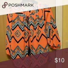 Colorful flowy shirt. Orange and teal chevron blouse with accent ties in the front. Quarter length sleeves. Tops Blouses