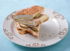 Brie And Smoked Turkey Panini This panini features a classic pairing of sweet and savory flavors: brie, pear, mustard and turkey (you could also try it with ham). Make the sandwich on a baguette and grill lightly using a panini press or skillet until the cheese melts.