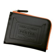 Porter Stand Original Multi Wallet. Ref : 384 - 02952. Size: W120/H90. Color : Black, Orange. Outer pocket can hold IC card. PORTER logo expressed by laser processing is a design point.