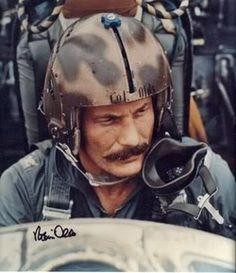 """Col Robin Olds, the triple ace USAF fighter pilot, with a combined 16 victories in WWII and Vietnam. Olds was particularly mentioned in regard to an """"old pirate"""" handlebar mustache he sported throughout his Vietnam deployment. He died in Fighter Pilot, Fighter Jets, Gi Joe, Robin Olds, Photo Avion, F4 Phantom, Human Rights Watch, Us Air Force, Vietnam War"""