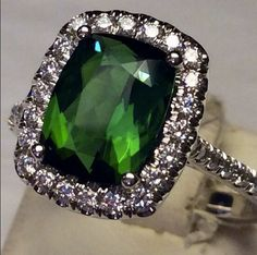 How amazing is that green color?!  14 Kt White Gold Tourmaline Diamond Ring.  Designed by @coastdiamond DIAMONDS