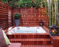 OUTDOOR hot tub, built into a beautiful teak floor in a fenced-in area, designed by Katie Leede, looks sophisticated! Description from pinterest.com. I searched for this on bing.com/images