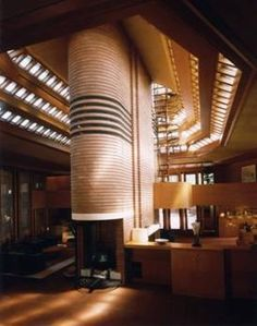 Frank Lloyd Wright's Wingspread*  An attractive structure which has dramatic light through those little windows at the ceiling that their rays make the area particular, again we can see using natural colors and natural materials such as wood because he is a fan of NATURE.