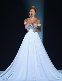 Jennifer Lopez In a Mariel Haenn GORGEOUS white glitter gown on American Idol. I imagine with lights shining this gown is Stunning!