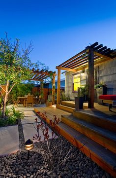 Redwood deck and pergola as well as a pergola over a seating area designed by Vorce Construction.