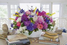 What is more gorgeous than a just clipped arrangement of fresh June blooms? Peonies, rhododendron, geraniums, yellow baptista, nepeta and salvia in a free flowing robust and nature-driven arrangement. Carolyne Roehm