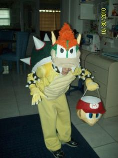 Bowser costume; the head is paper mache over a baseball cap then I decorated with cut up streamers and paint. Mario basket also made of paper mache, shell is sewn and stuffed, spikes on arms are made of Foamies-Halloween