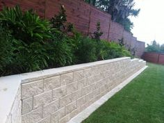 Tasman retaining wall system by Baines Masonry Blocks Backyard Retaining Walls, Retaining Wall Design, Concrete Retaining Walls, Backyard Patio, Patio Privacy, Outdoor Landscaping, Outdoor Gardens, Tiered Garden, Backyard Makeover