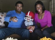 Black Family watching football   ... from watching the NFL the longer the replacement officials were used