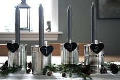Repurpose cans for an Advent wreath with numbered chalkboard hearts & candles.  Love.  Love.  Love.