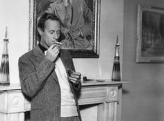 (Leslie Howard lights up at home. Lol, there's a portrait of himself behind him. <---- this comment made me laugh. Old Hollywood Glamour, Classic Hollywood, Hollywood Stars, Leslie Howard, Trevor Howard, I Look To You, Hattie Mcdaniel, Weak Men, Margaret Mitchell