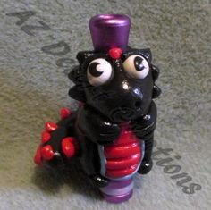 This is a custom order for Frank. Viper the Baby Dragon Drip tip. Viper the Baby Dragon is hand sculpted from polymer clay. Viper is black with red spikes and red tummy. He has blue on his tummy as we