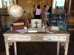 Vintage Guest Sign-in Table with globe and Bible for guests to sign, reflects the couple's Christian Faith and Ministry.