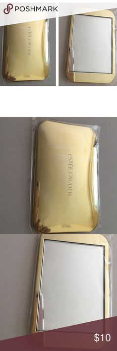 "Estée Lauder gold mirror NEW Estée Lauder travel sized pocket purse mirror Not a compact - gold metal back engraved Measures approx 4"" X 2.5"" New in bag and plastic from larger set Smoke free home Estee Lauder Makeup Brushes & Tools"
