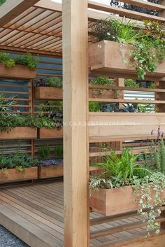 Covered Deck with windowbox container garden is a creative use of backyard space and landscaping idea for vertical space.