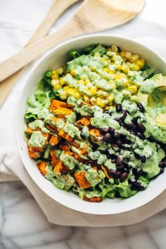 This healthy Spicy Southwestern Salad recipe has roasted sweet potatoes, black beans, corn, lettuce, and creamy avocado dressing! #sugarfree #glutenfree #vegan #healthy #saladrecipe #cleaneating | pinchofyum.com